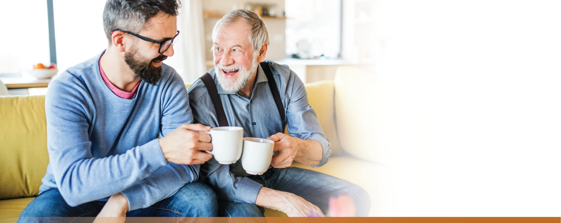 Adult male making a coffee mug toast with his father