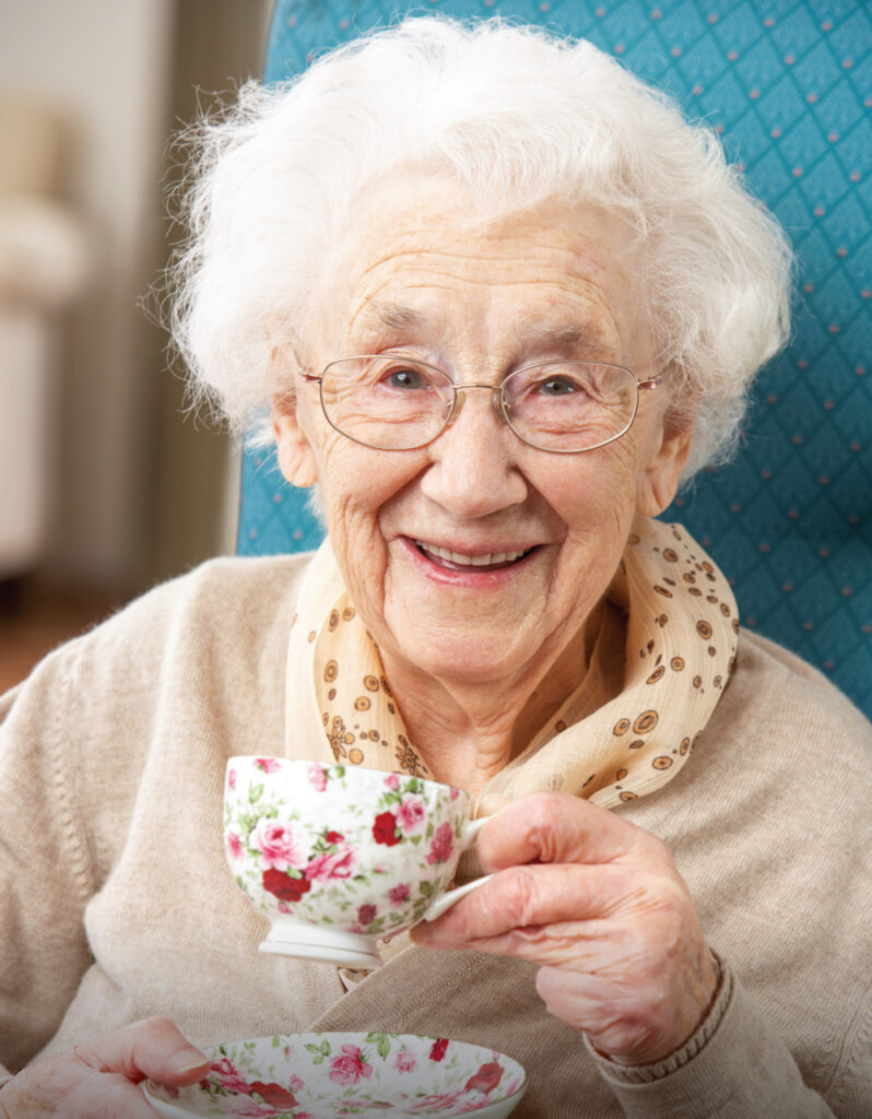 Happy Senior Woman drinking a cup of tea