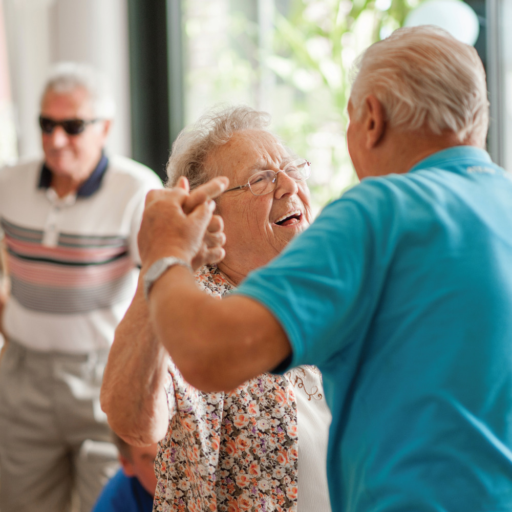 Senior Couple dancing at a community get together