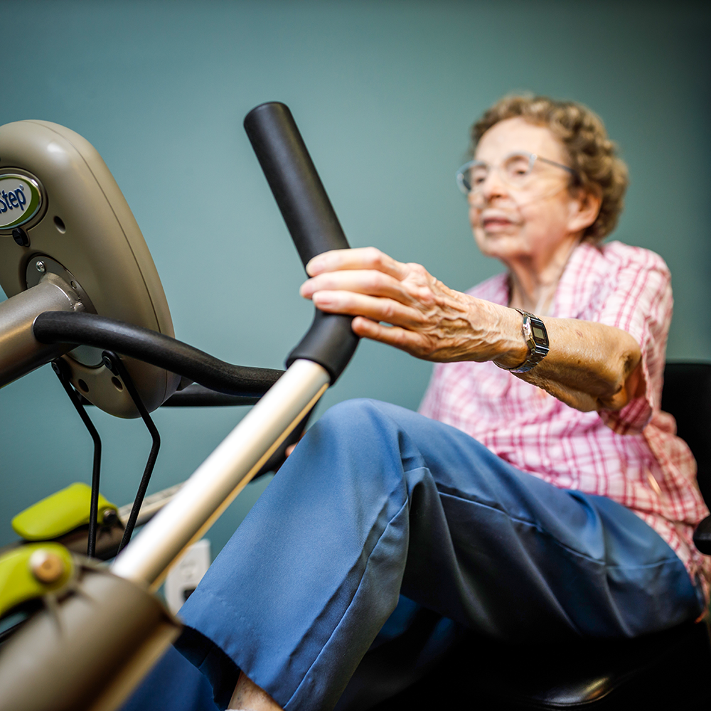 Senior woman working out on the exercise machine.